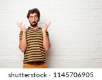 young dumb man joking  sticking ... | Shutterstock . vector #1145706905