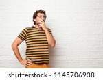 young dumb man coughing ... | Shutterstock . vector #1145706938