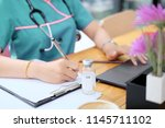 woman nurse working with... | Shutterstock . vector #1145711102