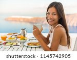 breakfast woman eating brunch... | Shutterstock . vector #1145742905