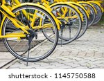 row of bicycles parked. yellow... | Shutterstock . vector #1145750588