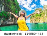 happy traveler asian woman in... | Shutterstock . vector #1145804465