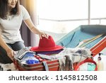 woman hand packing a luggage... | Shutterstock . vector #1145812508