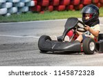 eight year old boy drives go... | Shutterstock . vector #1145872328