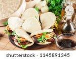 gua bao  steamed buns with pork ...   Shutterstock . vector #1145891345