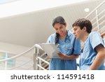 Nurse Holding A Clipboard Whil...