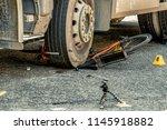 bicycle under tyre of truck.... | Shutterstock . vector #1145918882