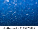 abstract blue sparkling glitter ...   Shutterstock . vector #1145928845