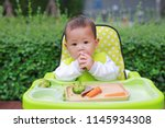 asian infant baby boy eating by ...   Shutterstock . vector #1145934308