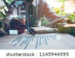 usiness hand working with new... | Shutterstock . vector #1145944595