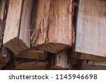 stacks of firewood. preparation ... | Shutterstock . vector #1145946698