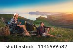 happy backpackers with a tent... | Shutterstock . vector #1145969582