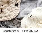 bunch of knitted warm pastel... | Shutterstock . vector #1145987765