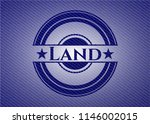 land emblem with jean background | Shutterstock .eps vector #1146002015