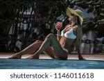 slim alluring woman in white... | Shutterstock . vector #1146011618