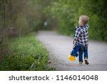 a boy kid is walking in the... | Shutterstock . vector #1146014048