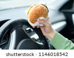 close up of driver's hand at... | Shutterstock . vector #1146018542