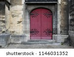 red arched church door. with... | Shutterstock . vector #1146031352