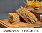 Stock photo club sandwich on a wooden board next to french fries and a cup of ketchup sauce the filling of 1146031718