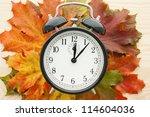 Retro Alarm Clock On Autumn...