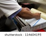 butcher wrapping meat   Shutterstock . vector #114604195