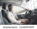stylish black businessman... | Shutterstock . vector #1146054305