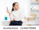 let me think. child girl wears... | Shutterstock . vector #1146070088