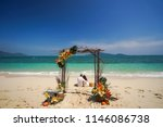 a pair of newlyweds are sitting ... | Shutterstock . vector #1146086738