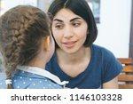 mother teaching daughter at... | Shutterstock . vector #1146103328