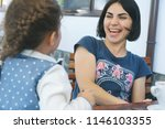 laughing mother looking at... | Shutterstock . vector #1146103355