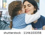 girl hugging mother with closed ... | Shutterstock . vector #1146103358