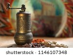 uzbek mill for spices with... | Shutterstock . vector #1146107348