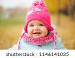 cute happy girl in autumn park | Shutterstock . vector #1146141035