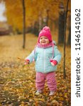 cute happy girl in autumn park | Shutterstock . vector #1146141062