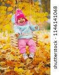 little girl on swings in autumn ... | Shutterstock . vector #1146141068