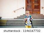 happy smiling kid in glasses is ... | Shutterstock . vector #1146167732