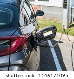 a hybrid car which is also an... | Shutterstock . vector #1146171095
