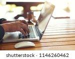 businessman sitting at coffee... | Shutterstock . vector #1146260462