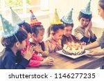 group of children is blowing... | Shutterstock . vector #1146277235