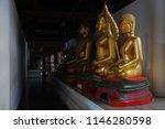 golden buddha statues in wat...   Shutterstock . vector #1146280598