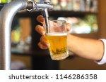 hands bartender holding a glass ... | Shutterstock . vector #1146286358