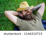 man bearded cowboy lay on grass ... | Shutterstock . vector #1146313715