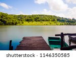 wooden pier or jetty and a boat ... | Shutterstock . vector #1146350585