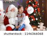 authentic santa claus taking... | Shutterstock . vector #1146366068