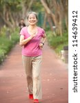 senior chinese woman jogging in ... | Shutterstock . vector #114639412