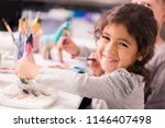 little girls decorating small... | Shutterstock . vector #1146407498