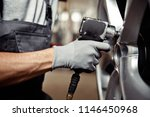 a young man is repairing a car... | Shutterstock . vector #1146450968