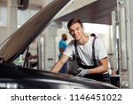 a young mechanic is checking... | Shutterstock . vector #1146451022