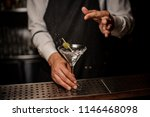 bartender making a fresh and... | Shutterstock . vector #1146468098