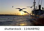 Moored Ship At Sunset In...
